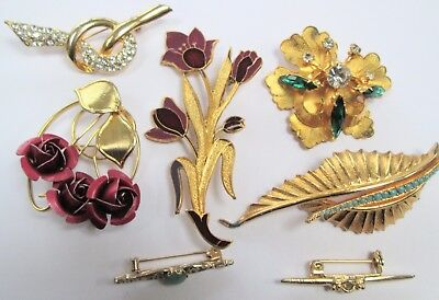 Seven vintage gold metal brooches (enamel, diamond paste, turquoise paste etc)