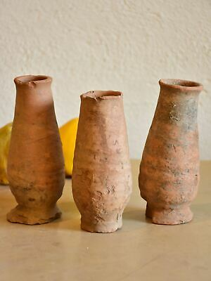 Three ancient terracotta strawberry storage pots