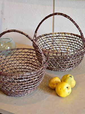 Pair of vintage French woven fishing baskets