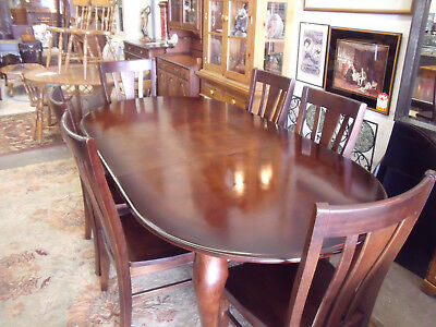 Bassett Mahogany Dining Room Table with leaf and six chairs