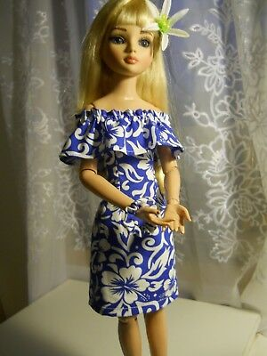 Ellowyne modeling a Blue/White Hybiscus floral Hawaii'n Dress