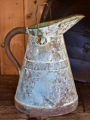 Antique French watering can with aqua patina