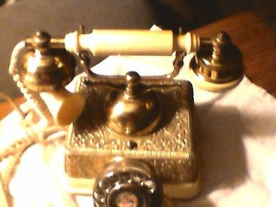 Vintage Rotary dial French Victorian phone.  brass and gold tone embossed