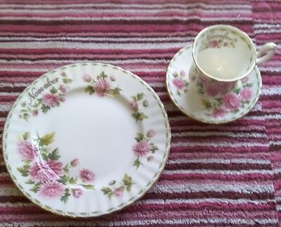 Royal albert flower of the month collection. Tea cup and saucer and plate.