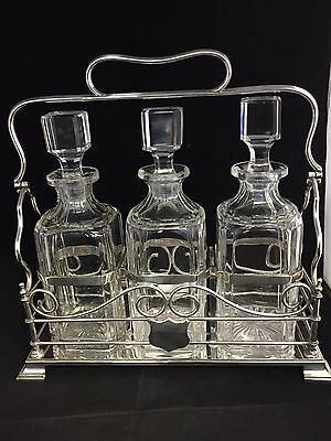 Victorian/Georgian Silver Plated Tantalus with 3 Cut Glass Decanters