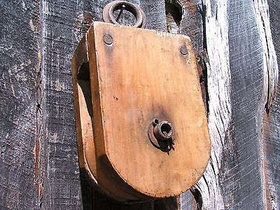 Old Wooden pulley with wood wheel