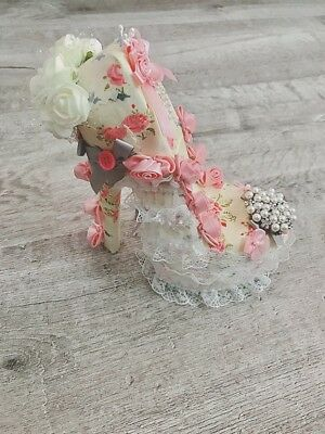 shabby chic shoes. Cover it with fabric and decorate it.