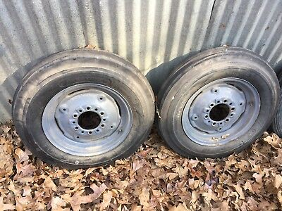 Ferguson/Ford Tractor 2 new 6.00x16 inch new tires and 2 good no rustsolidwheels