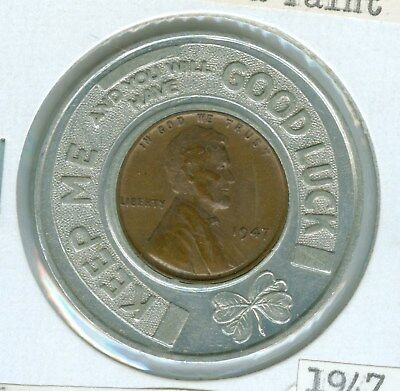 Encased By N.c.i. Feed And Paint Co. Of Algona, Iowa A 1947 Lincoln Cent