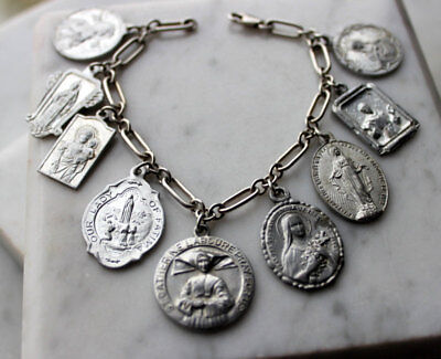 Vintage religious medals charm bracelet on sterling silver chain