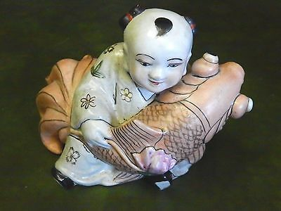Vintage Japanese Painted  Ceramic Or Pottery Child Figure With Fish