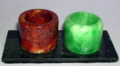 FINE PAIR HARDSTONE / JADE ARCHER'S RINGS on Stone Stand