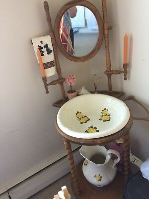 Antique wash basin stand with bowl and pitcher.