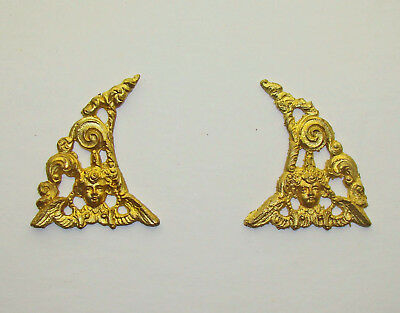 A good pair of cherub face dial-arch spandrels for tall-case or large bracket