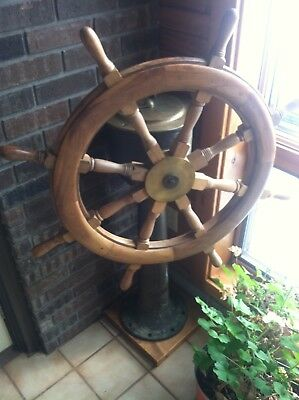 Solid Brass steering pedestal with wood wheel in good condition