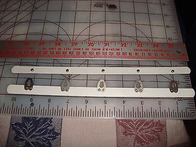 corset busk 10 1/2 inch (27 cm) white coated steel w/ five buttons/loops