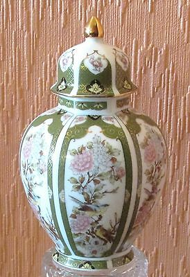 """Small Japanese Temple Jar Imported by Arnart featuring the """"King of Flowers""""."""