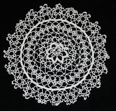 Vintage intricate tatted lace round doily measuring 20cm across