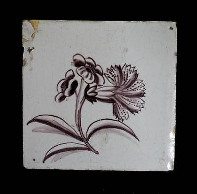Antique 18th 19th century Delft Dutch manganese pottery tile with flower design.