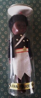 1960's world souvenir plastic doll in plastic tube Fijian policeman