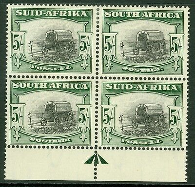 SG 122 South Africa 1947-54. 5/- black & pale blue/green block of 4. Top pair...