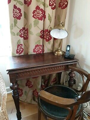 Carved Oak console/ Tea table extending out to a square table 19th Century