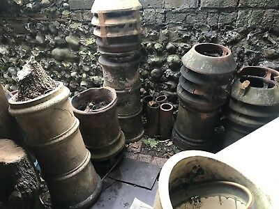 selection of 6 old chimney pots varying heights and condition