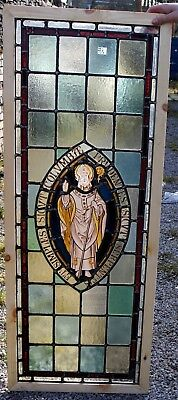 A large painted stained glass window