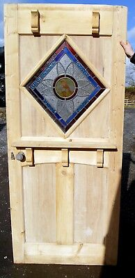 A fabulous antique stained glass front door with painted bird centre