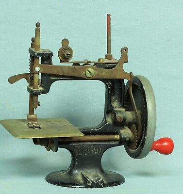 Antique Peter Pan Hand Crank Cast Iron Toy Sewing Machine