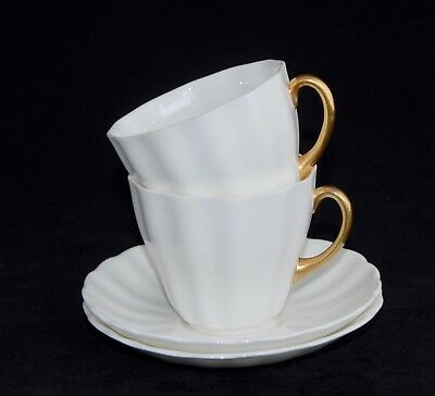 Pair of 1943 Royal Doulton Tea Cups and Saucers C7548 - White w Gold Handles