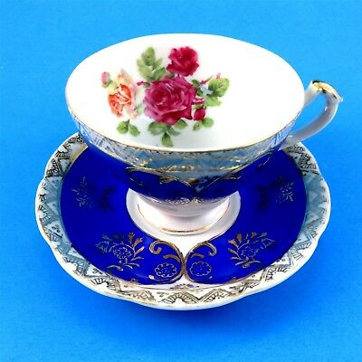 Electric Blue and Gold Exterior with Rose Bouquet Japan Tea Cup and Saucer Set