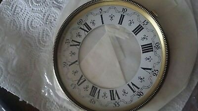 Antique clock face metal surround and glass included 4.5, 11cm approx. N.O.S.