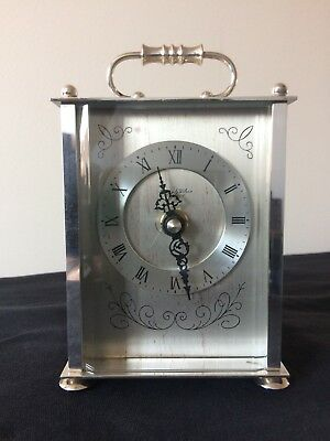 Silver plated battery Carriage clock by Anstey and Wilson of London.