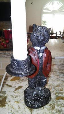 antique cast iron cat door stop and candle holder