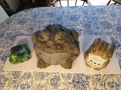 Two ceramic frogs a planter and a candle illuminator the third is plastic
