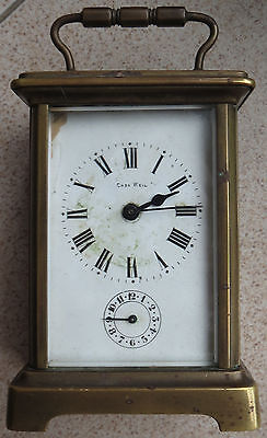 French Brass Carriage Alarm Clock 11,5 cm. x 8 cm. x 6,5 cm. aside enamel dial