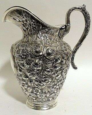 A large sterling repousse water pitcher, Hennegan, Bates & Co., Baltimore.