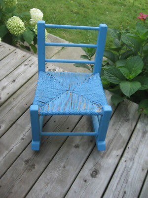 """ANTIQUE CHILD'S ROCKING CHAIR  PINE WOOD bailing corde 19""""in tall 12""""in wide"""