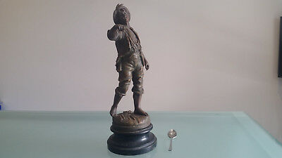 SPELTER FIGURINE OF A BOY (c1900) BY ROUSSEAU. WAS HOLDING SOMETHING.