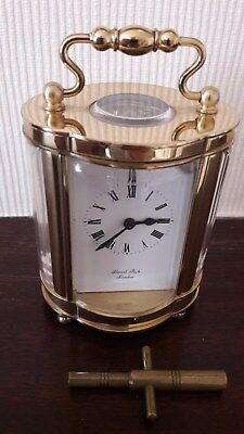 Carriege Clock - Lionel Peck, London) Brass oval shaped