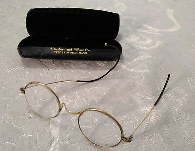 Antique gold tone rimmed and round eyeglasses.