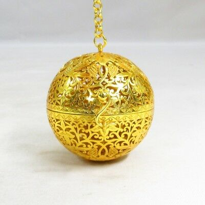 A140: Japanese sphere hanging incense burner of metal with good openwork