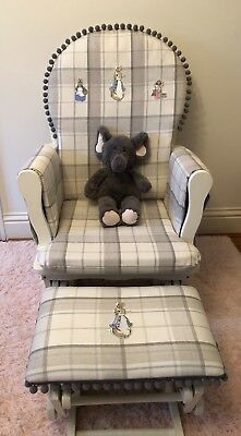Nursing chair with gliding/rocking motion and foot stool Laura Ashley Fabric.