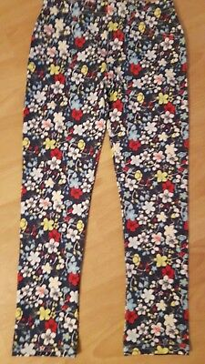 Young girl's floral blue trousers by M and S. New. Size 5/6 years