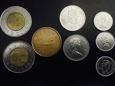 2 Canadian Toonie 2 Dollar Coin plus one dollar 2 quarters 3 dimes $5.80 face