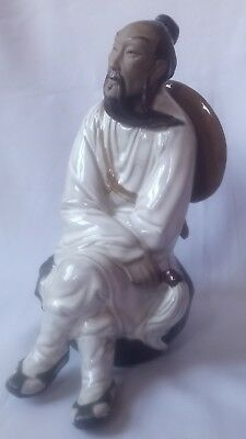 "Chinese Mud Man Figurine~Seated- Hat on his back, 9"" high"