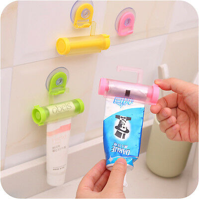 Lovely Rolling Squeezer Toothpaste Dispenser Bathroom Holder Sucker Hanging