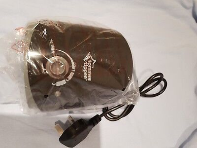 Tommee tippee electric bottle warmer. Black. Never been used. Still in cover.