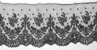 450 cms. antique black hand made Chantilly lace border